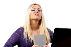 Girl with book and laptop Stock Images