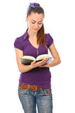 Girl with book at library Stock Images