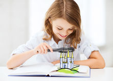 Girl with book looking to castle through magnifier. People, childhood, literature and imagination concept - little girl with book looking to fairy castle through Royalty Free Stock Photo