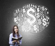 Girl with book and money cloud Stock Photos