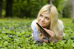 Girl with book outdoor. Royalty Free Stock Photography