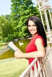 Girl with book outdoor Stock Photo