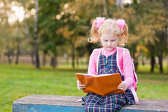 Girl with book outdoor Royalty Free Stock Photography