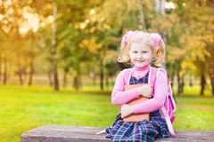 Girl with book outdoor Royalty Free Stock Photo
