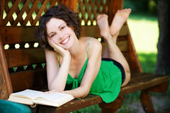 Girl with book outdoors Stock Image