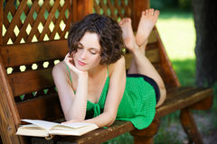 Girl with book outdoors Royalty Free Stock Images