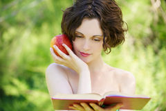 Girl with book outdoors Royalty Free Stock Photo