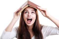 Girl with book over her head Royalty Free Stock Photography