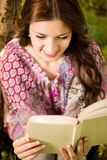 Girl with a book in the park Royalty Free Stock Images