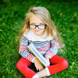 Girl with a book in the park Royalty Free Stock Photography