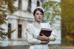 The girl with a book in the park. Royalty Free Stock Photos