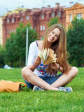 Girl with a book in the park Stock Image