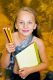 Girl with book and pencil. In her hands Stock Image