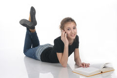 Girl with book and phone Royalty Free Stock Images