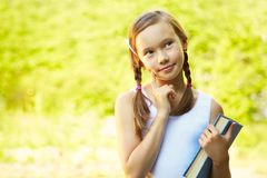 Girl with a book Royalty Free Stock Images