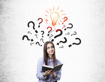 Girl with book and question marks with bulb Stock Photography