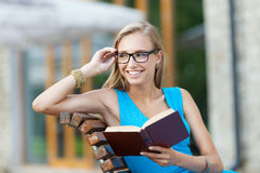 Girl with a book Stock Photos