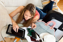 Girl book tickets online Royalty Free Stock Photo