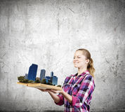 Girl with book. Young woman in casual holding opened book with city model royalty free stock images
