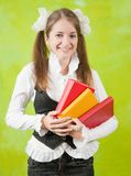 Girl with books Stock Images