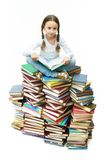Girl on books Stock Photo