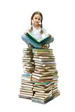 Girl on books Royalty Free Stock Photos