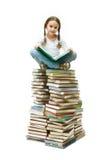 Girl on books Royalty Free Stock Photos