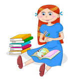 Girl with books. Girl reading a book next to a pile of books Stock Images