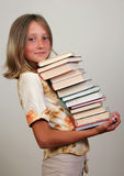 Girl with books. Girl with stack of books Royalty Free Stock Image