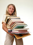 Girl with books. Funny girl with stack of books Stock Images