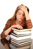 Girl with books 3. Young girl worried about having too much to study, isolated on white Royalty Free Stock Image