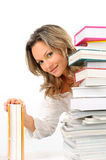 Girl between books Royalty Free Stock Photography