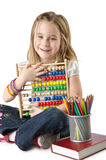 Girl with books and abacus Stock Photography