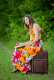Girl with books and apple. The girl with the book and an apple in nature Stock Image