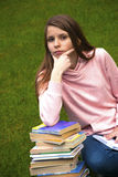Girl with  books. Beautiful girl with books on the grass Stock Photo