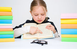 Girl with books. Cute girl with colored books Stock Photo