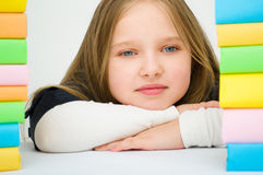 Girl with books. Cute girl with colored books Royalty Free Stock Photos