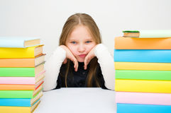 Girl with books. Cute girl with colored books Royalty Free Stock Images
