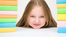 Girl with books. Cute girl with colored books Stock Image