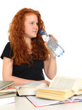 Girl with books is drinking Royalty Free Stock Photos