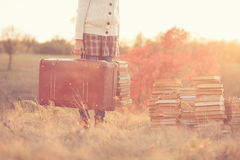 Girl with books. In fall Royalty Free Stock Image