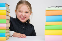 Girl with books. Happy girl with colored books Stock Photos