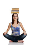 Girl with books on her head. Stock Images