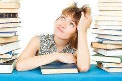 Girl with books isolated on white background. In the library Royalty Free Stock Photos