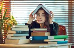 Girl among books Stock Image
