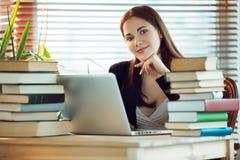 Girl among books stock photo