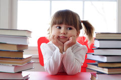 Girl and books for reading Stock Photos