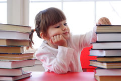 Girl and books for reading Stock Photo