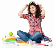 Girl with books sitting on floor Stock Photos