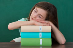 Girl With Books Sleeping At Desk Stock Image
